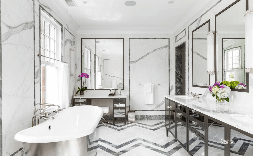 patterned tile floor with marble walls