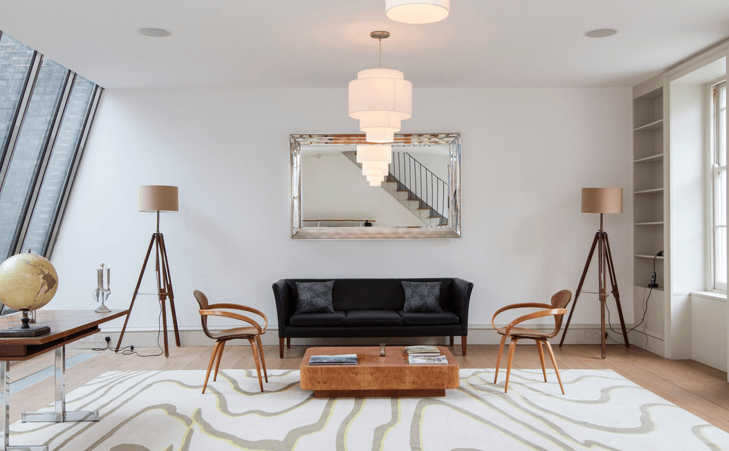 mirror above simple seating area
