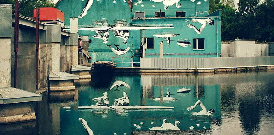 Upside-Down Wall Mural Unveiled in River Reflection
