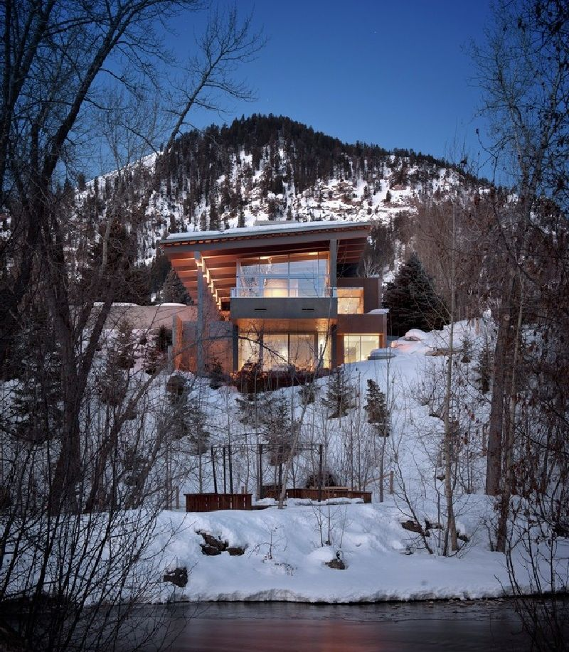 Anchored in a harsh terrain in the rocky mountains the - House in the mountains ...
