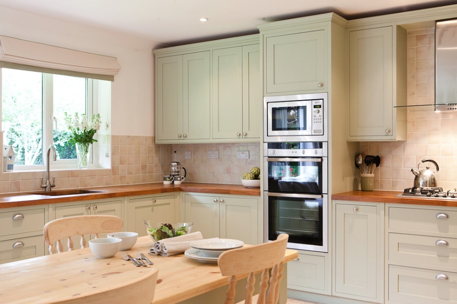 pale green painted kitchen cabinets
