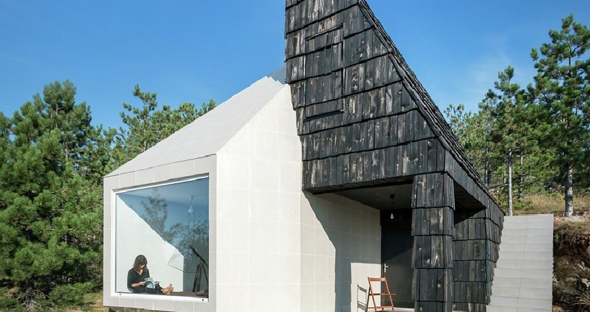 Monolithic Silhouette of Mountain Home in Serbia Contrasts With Landscape