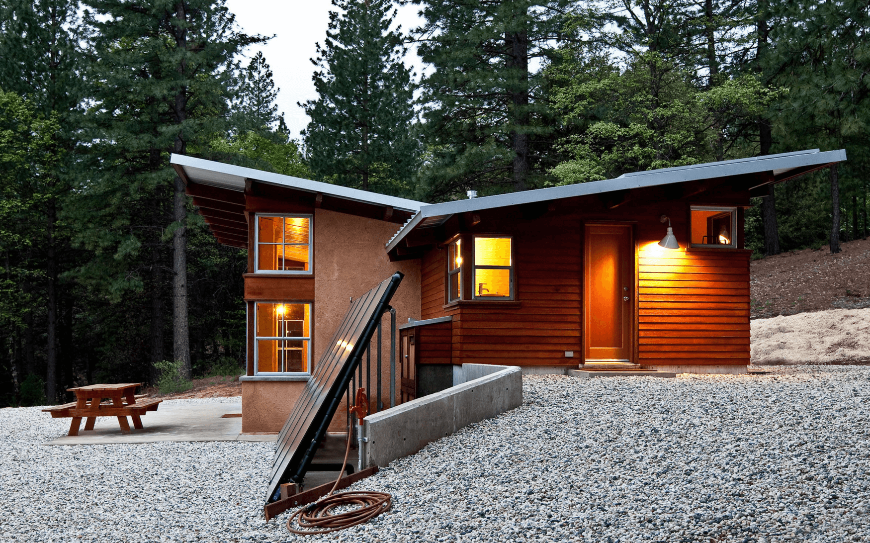 An edgy, cabin-inspired home in the woods. Image Source: Arkin Tilt Architects