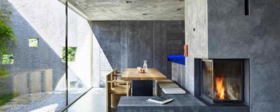 Tiny Concrete Bunker Opens to a 3-Story Home Filled With Light