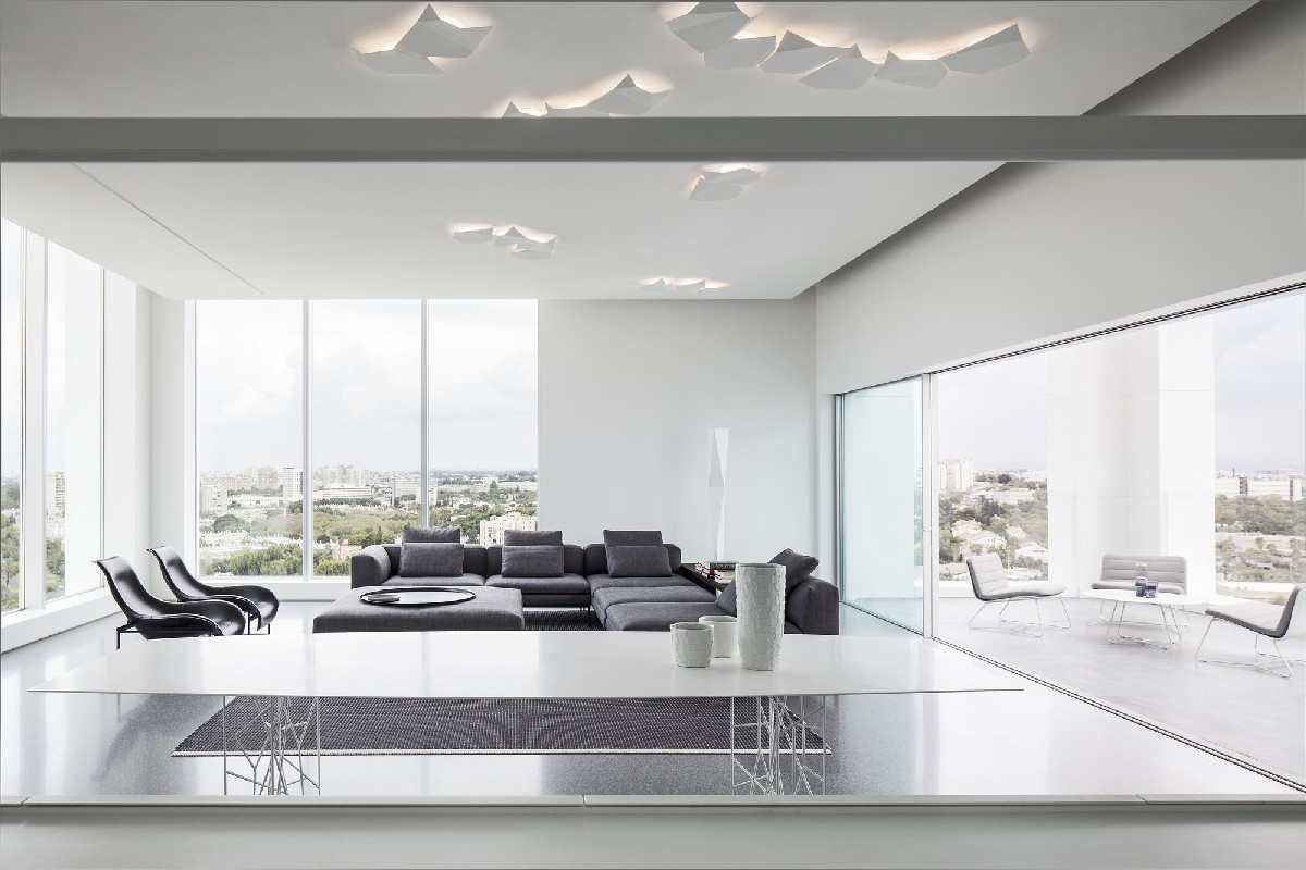 Minimalist penthouse in israel focuses attention on city views