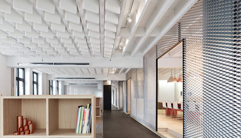 Aluminum Mesh Partitions Define Industrial-Inspired Office in Germany