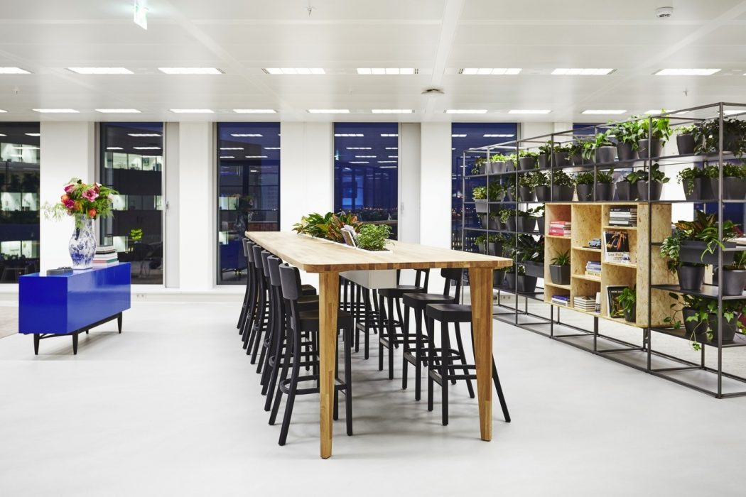 Long meeting table - modern office design Amsterdam