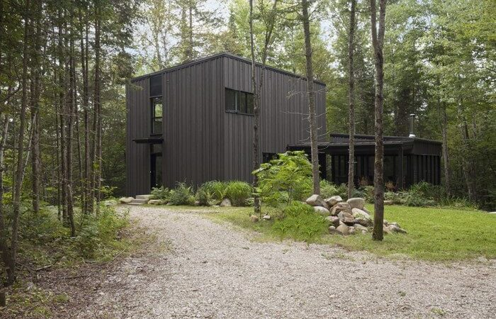 Hilltop Home Mirrors Quebec's Spruce Forests