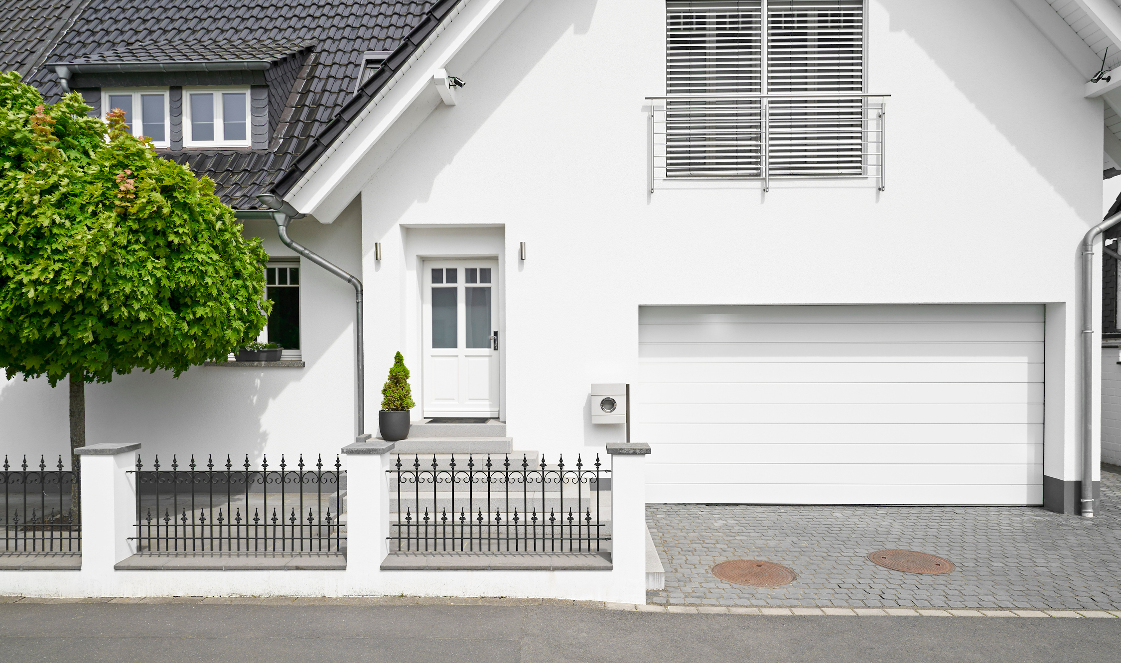 Germany, Cologne, white new built one-family house with garage