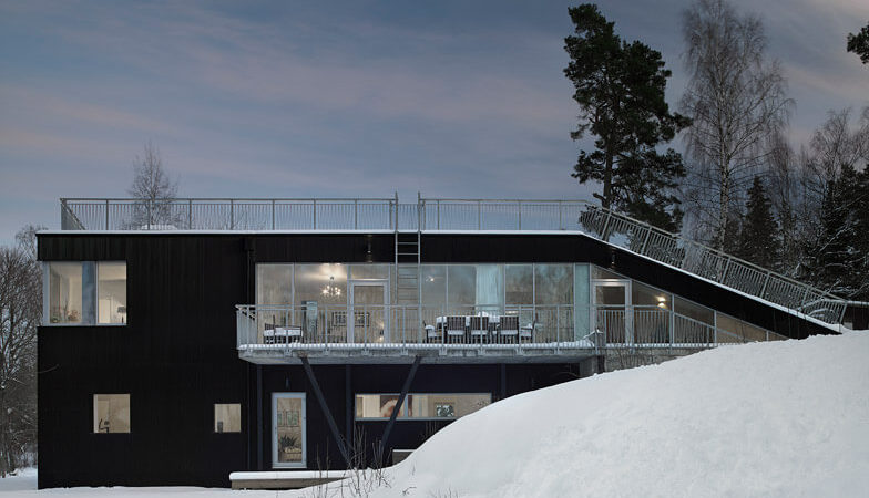 A Sled Hill Roof Transforms this Swedish Home into a Wintry Playground