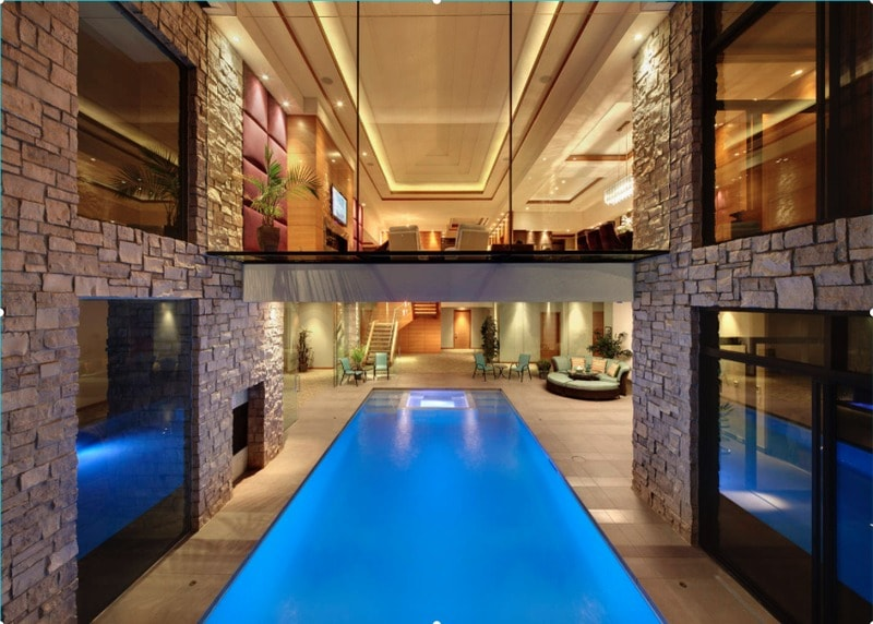 long contemporary indoor/outdoor swimming pool design