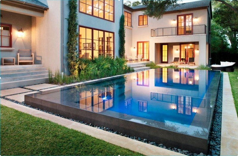 raised-edge swimming pool and river rock decorating ideas for swimming pools - freshome.com
