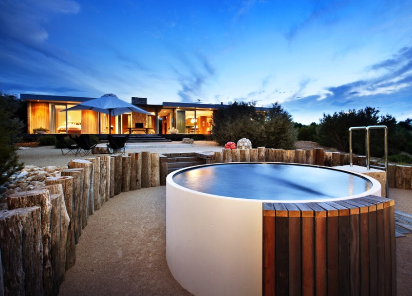 A Contemporary Above Ground Plunge Pool With Wood Detailing That Provides Seating And Hides The S Filtration System Image Urban Angles