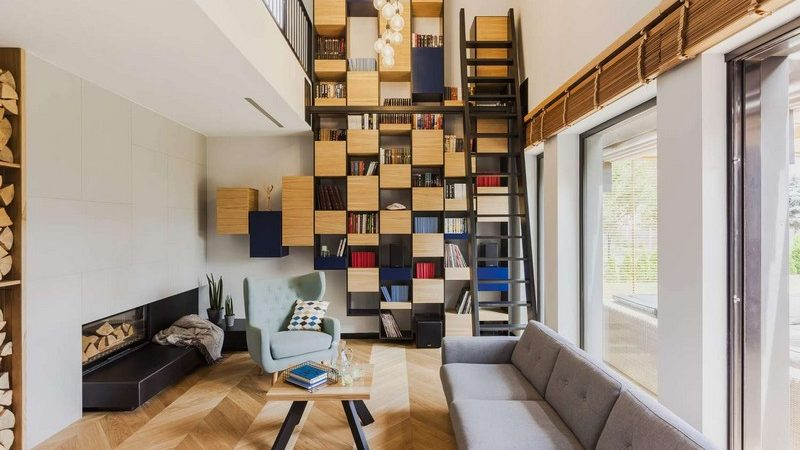 Modern Residence in Poland Highlights Floor-to-Ceiling Bookcase