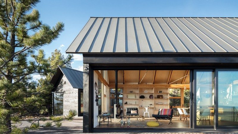 Sister Cabins Frame Sweeping Views of Rocky Mountains, Colorado