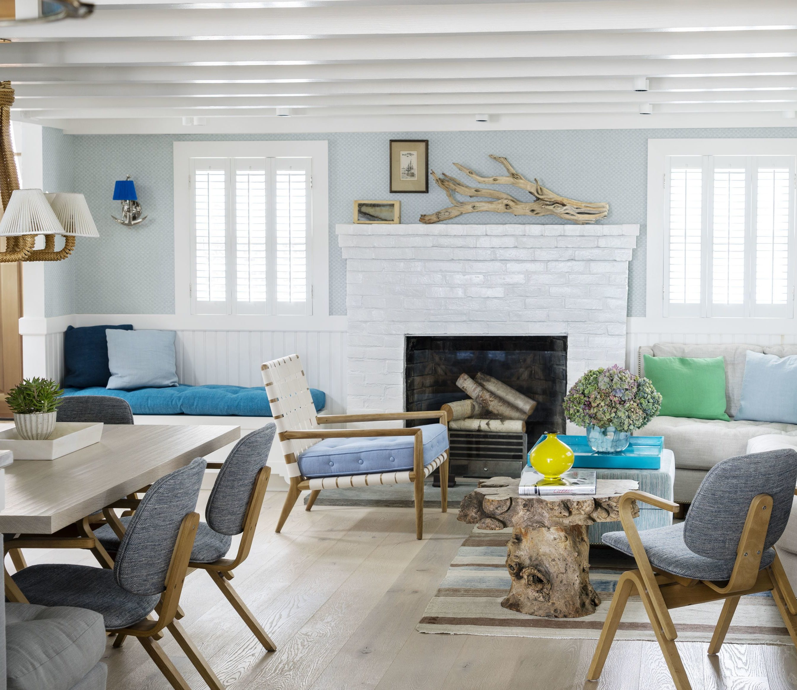 Driftwood Over The Mantel And As Base Of A Table Add To Modern Coastal Look This Open Floor Plan Living E Image House Beautiful
