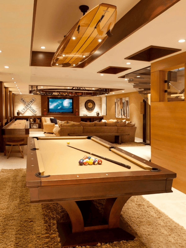 surfboards in home decor - game room