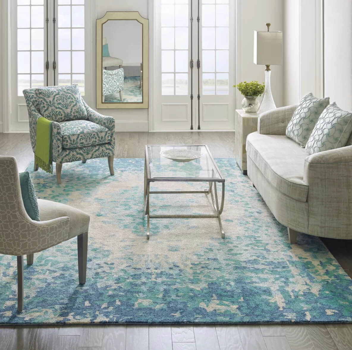 12 living room rug ideas that will change everythingthe looking glass rug adds romance to a living room with an impressionistic floral pattern image perigold