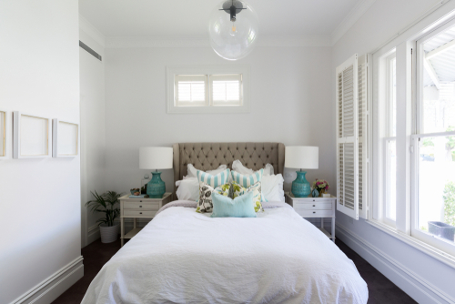 White bedroom with blue accents small space mistakes