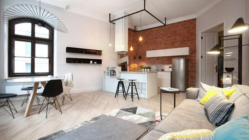 A Gracefully Rejuvenated Industrial-Style Apartment in Warsaw