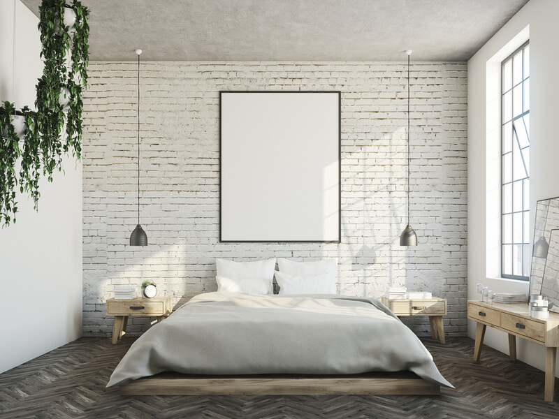 Modern master bedroom with brick wall