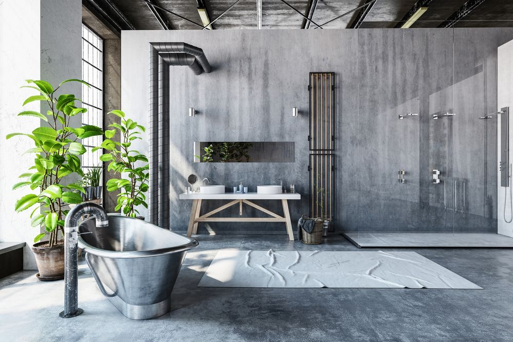 Exposed pipes create an industrial vibe in this bathroom