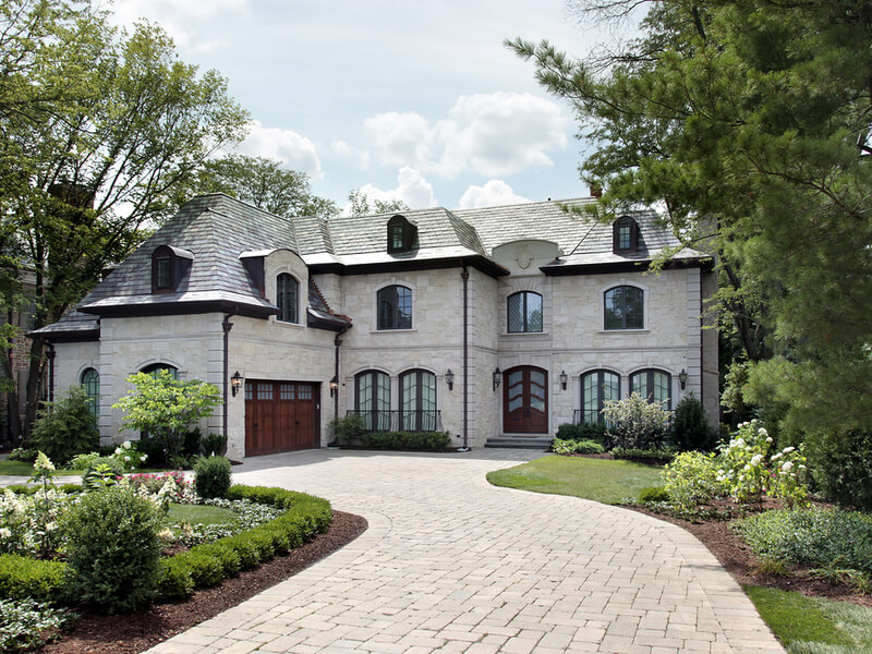 French-style home with paved driveway