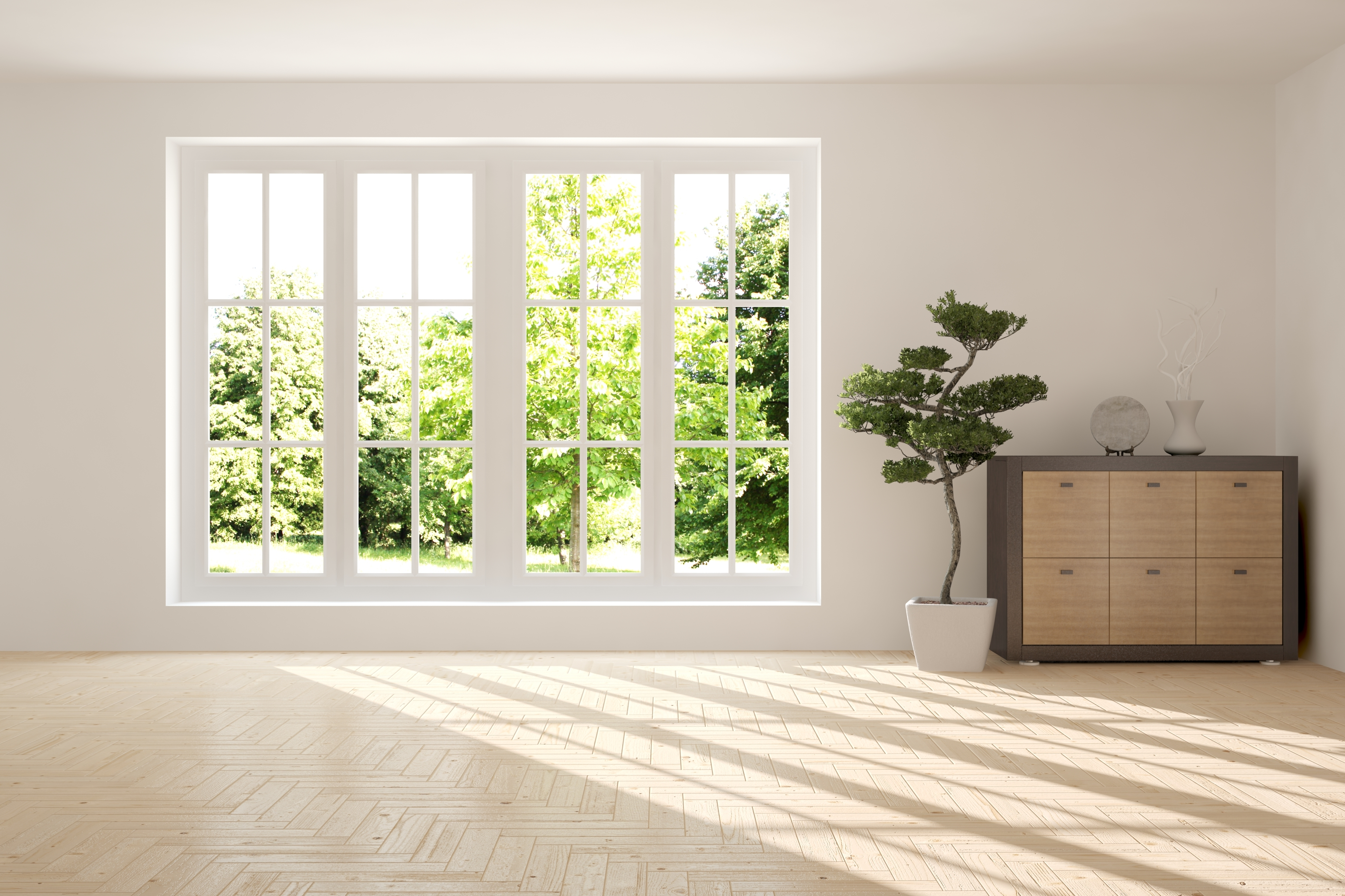 large window in empty room with wood floors