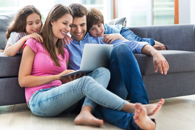 family watching netflix on laptop